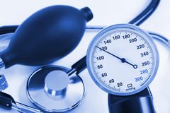Scale of pressure and stethoscope Royalty Free Stock Photography