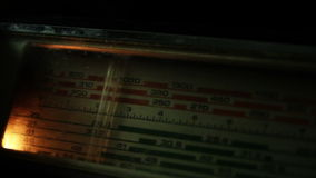 Scale radio - tunes to a station. Radio dial in the dark - tuning to a radio station stock footage