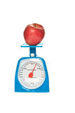 Scale and red apple Stock Photography