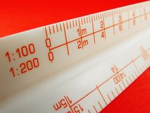 Scale Rule Red. Scale rule depicting 1:100 and 1:200 scales. Used to read scaled drawings Stock Photography
