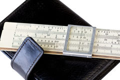 Scale ruler on black moleskin Royalty Free Stock Photography