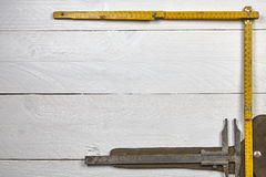 Scale ruler on a white table Royalty Free Stock Image