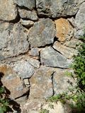 Scale, stone, rock, concretion, calculus. Wall of a castle made of stone, foundation of a fortress, ancient building, stone background view royalty free stock photography