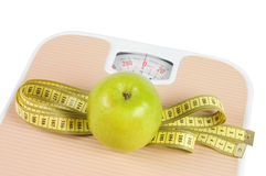 Free Scale, Tape And Apple On White Stock Photography - 18081032