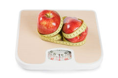 Scale, Tape And Apple On White Stock Image