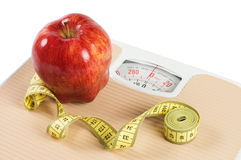 Scale, tape and apple diet concept Stock Images