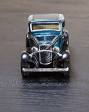 Scale toy model Ford Coupe. A petrol blue scale toy model of a 1932 Ford 3-window Coupe - front view Royalty Free Stock Photography