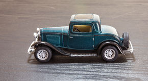 Scale toy model Ford Coupe. A petrol blue scale toy model of a 1932 Ford 3-window Coupe - side view Stock Photos