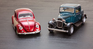 Scale toy model Ford Coupe and VW Beetle Royalty Free Stock Photos