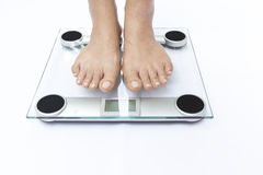 A scale with two feet Stock Image