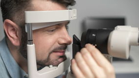 Scaled up of bearded man undergoing eye examination
