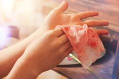 Scaled up look on creative child wiping hands Stock Image