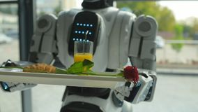 Scaled up look on robot holding trey with breakfast stock video footage