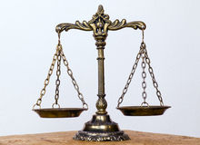 Scales. A photo of the scales of justice with a balance theme overlay stock photos