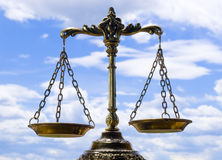 Scales. A photo of the scales of justice with a balance theme overlay stock image