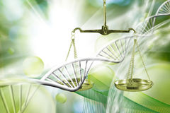 Scales against chain of DNA background Stock Photo