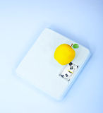 Scales and apple Royalty Free Stock Photos