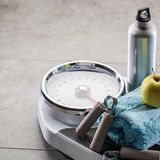 Scales after athletic training, aerobics and weight control at gym Stock Images
