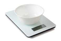 Scales and a bowl Royalty Free Stock Images