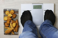 Scales calories pastry weight. Electronic scales and weight loss concept of proper nutrition for weight loss Stock Photos