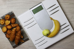 Scales calories pastry weight. Electronic scales and weight loss concept of proper nutrition for weight loss Stock Photo