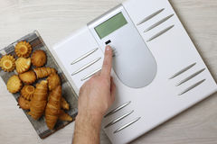 Scales calories pastry weight. Electronic scales and weight loss concept of proper nutrition for weight loss Stock Images