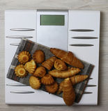 Scales calories pastry weight. Electronic scales and weight loss concept of proper nutrition for weight loss Stock Photography
