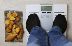 Scales calories pastry weight. Electronic scales and weight loss concept of proper nutrition for weight loss Royalty Free Stock Photos