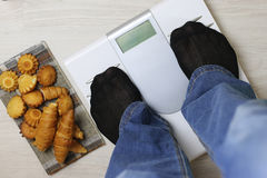 Scales calories pastry weight Stock Image