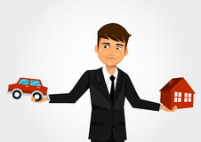 Scales with car and home. Businessman Scales with car and home Stock Photo