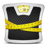 Scales Diet Concept. Measuring tape wrapped around bathroom scales. Concept of weight loss, diet, healthy lifestyle Royalty Free Stock Image