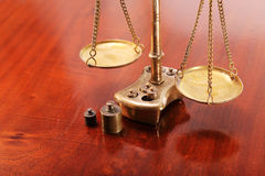 Scales with dishes on the chains as a symbol of legal Royalty Free Stock Images
