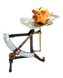 Scales with dollar notes and piggybank Royalty Free Stock Photography