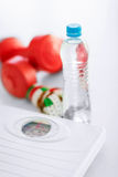 Scales, dumbbells, bottle of water, measuring tape Stock Images