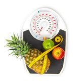 Scales and fruit Stock Images