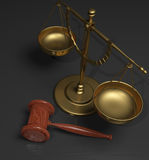 Scales and gavel. Gold or brass scales of justice and wood gavel on a grey and black background Stock Images