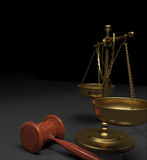 Scales and gavel. Gold or brass scales of justice and wood gavel on a grey and black background Royalty Free Stock Image