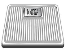 Scales with the inscription don't panic Royalty Free Stock Images