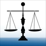 Scales of justice. Salces of Justice perfectly balanced on crafted pole Royalty Free Stock Image