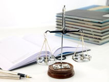 Scales of justice. With books Stock Image