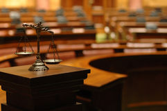 Scales of Justice. Symbol of law and justice in the empty courtroom, law and justice concept royalty free stock image
