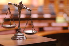 Scales of Justice. Symbol of law and justice in the empty courtroom, law and justice concept
