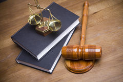 Scales of Justice!. Code of justice and gavel on desk with dark background Stock Photography