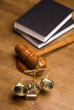 Scales of Justice!. Code of justice and gavel on desk with dark background Stock Photo