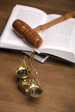 Scales of Justice!. Scales of justice and gavel on desk with dark background Stock Photos