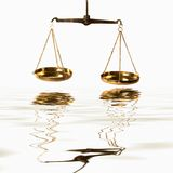 Scales Of Justice. Measuring scales of justice cast a reflection in still waters - Law, Legal Themes royalty free stock photos