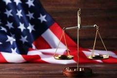 Scales of justice with american flag Royalty Free Stock Images