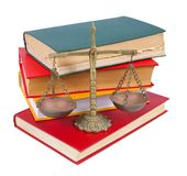 Scales of justice atop  books Stock Images
