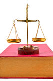 Scales of justice atop books Stock Photo