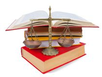 Scales of justice atop legal books over white. Scales of justice atop legal books. Isolated with clipping path over white background royalty free stock photo
